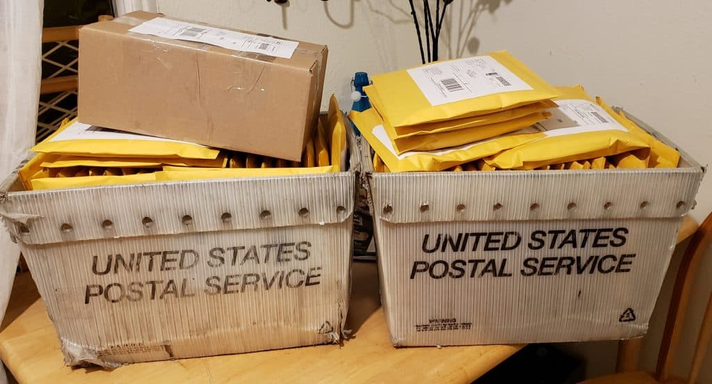2 USPS boxes of addressed yellow envelopes containing Issue 20